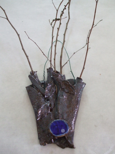 clay and glass twig holder.jpg