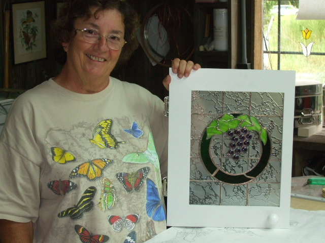 gail and one of her two windows.jpg