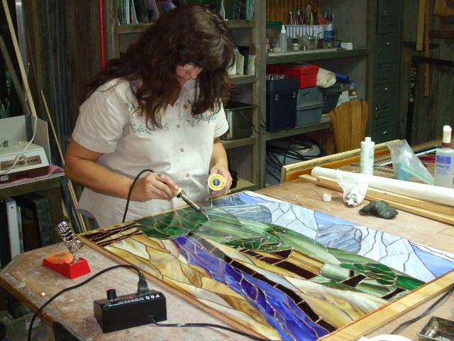 julie working on her big window.jpg