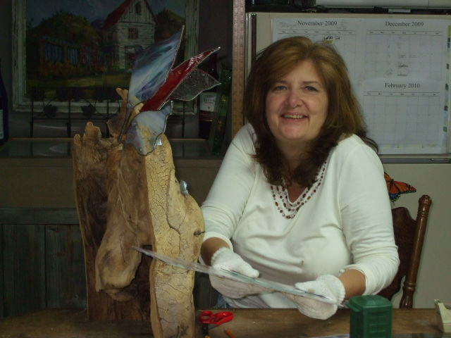 pam and her wood angel attaching wings.jpg