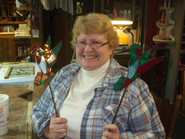Joyce and her garden stakes.jpg