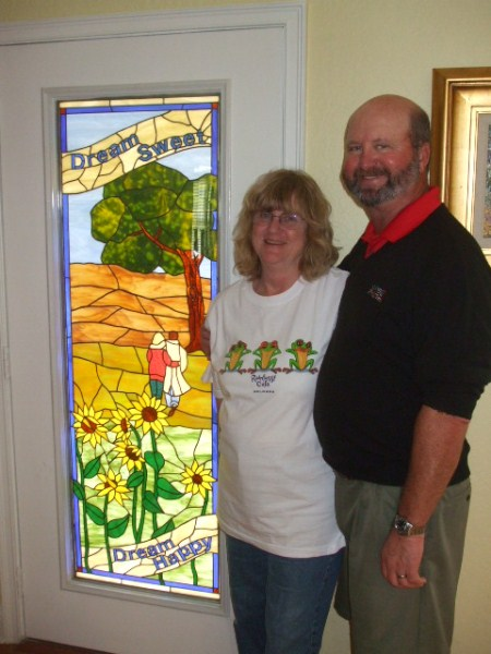 Rick, Cheri and their new window.jpg